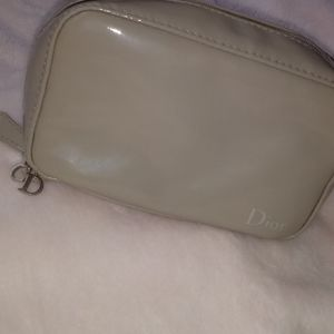 Dior light brown makeup bag